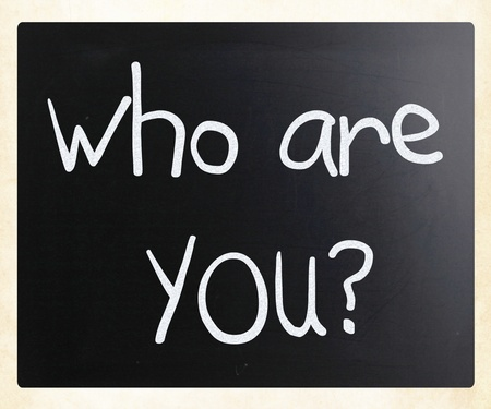 'Who are you' handwritten with white chalk on a blackboard photo