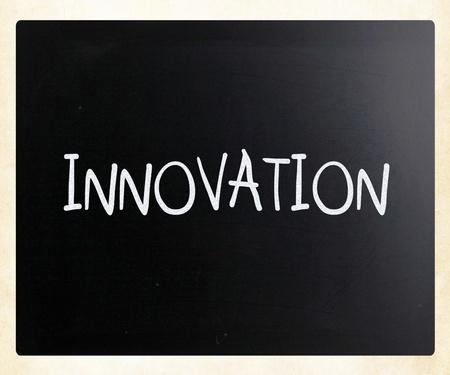 Innovation handwritten with white chalk on a blackboard photo