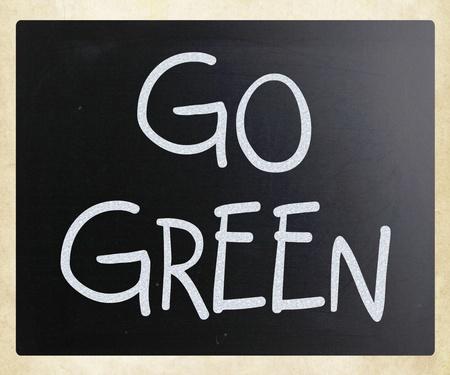 Go green handwritten with white chalk on a blackboard photo