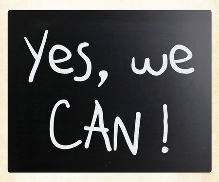Yes, we can! handwritten with white chalk on a blackboard photo