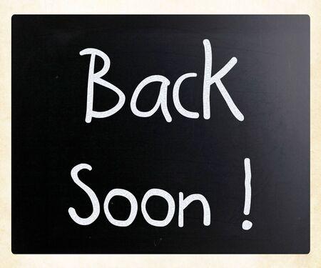 Back soon! handwritten with white chalk on a blackboard photo