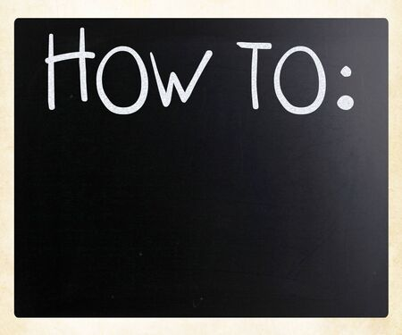 'How To' handwritten with white chalk on a blackboard photo