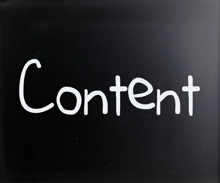The word 'Content' handwritten with white chalk on a blackboard photo