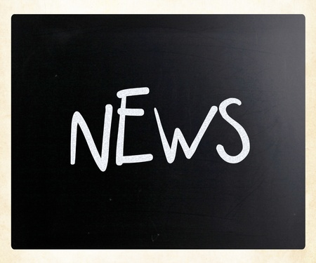 The word News handwritten with white chalk on a blackboard photo