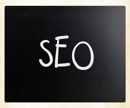 The word SEO handwritten with white chalk on a blackboard photo