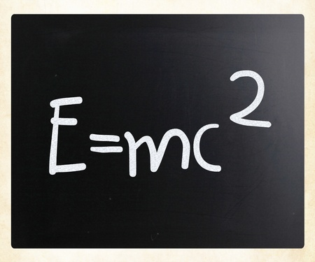 math symbols: E=mc2 handwritten with white chalk on a blackboard