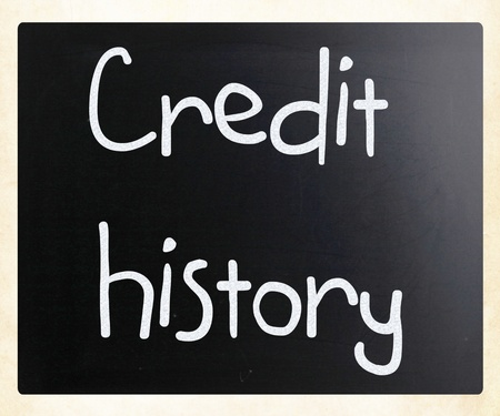 creditworthiness: Credit history handwritten with white chalk on a blackboard Stock Photo