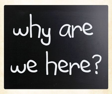existence: why are we here handwritten with white chalk on a blackboard Stock Photo