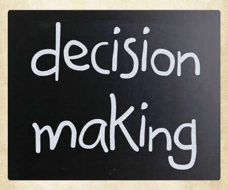 decision making: Decision making handwritten with white chalk on a blackboard