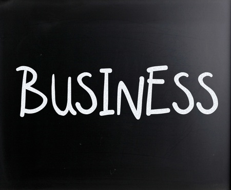 The word Business handwritten with white chalk on a blackboard photo