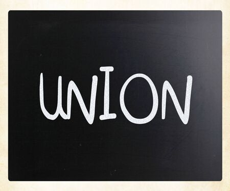 The word Union handwritten with white chalk on a blackboard photo