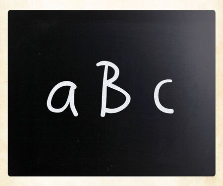abc handwritten with white chalk on a blackboard photo