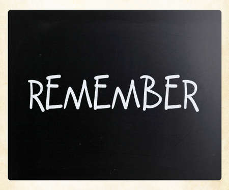 Remember handwritten with white chalk on a blackboard photo