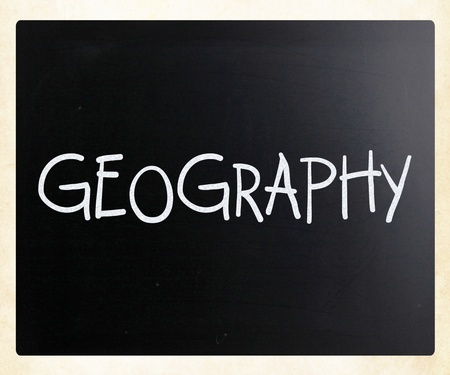 Geography handwritten with white chalk on a blackboard photo