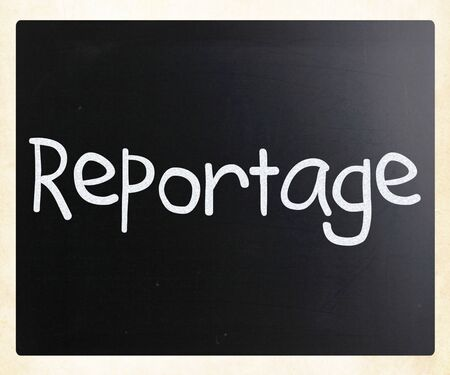 'Reportage' handwritten with white chalk on a blackboard photo