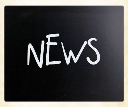 News handwritten with white chalk on a blackboard photo