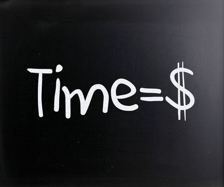 sign equals: Time is money handwritten with white chalk on a blackboard