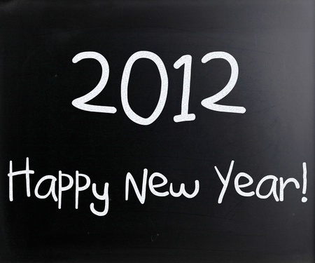 'Happy New Year' handwritten with white chalk on a blackboard photo