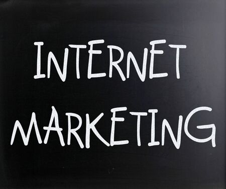 'Internet marketing' handwritten with white chalk on a blackboard photo