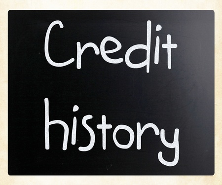 Credit history handwritten with white chalk on a blackboard photo