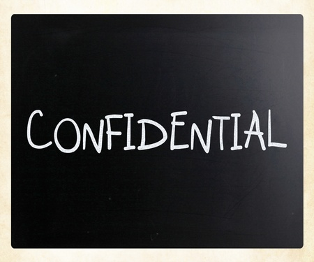 The word 'Confidential' handwritten with white chalk on a blackboard photo