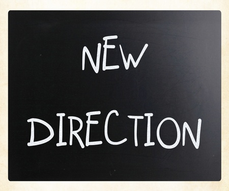 New direction handwritten with white chalk on a blackboard photo