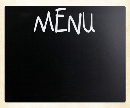 The word 'Menu' handwritten with white chalk on a blackboard photo