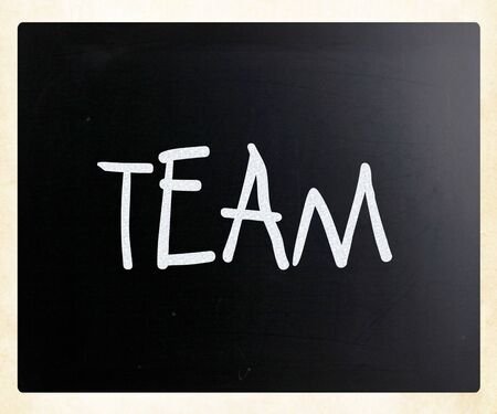 concerted: The word TEAM handwritten with white chalk on a blackboard