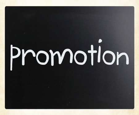 The word promotion handwritten with white chalk on a blackboard photo