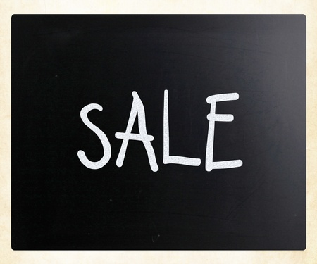 Sale handwritten with white chalk on a blackboard photo