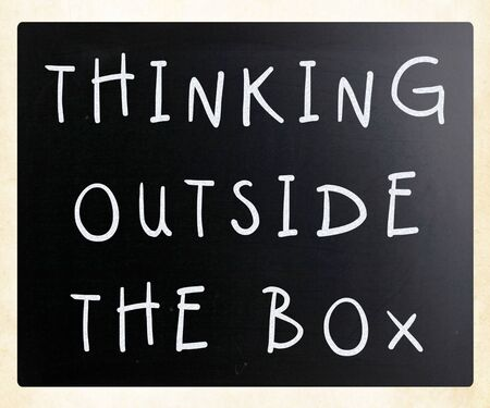 Thinking outside the box phrase, handwritten with white chalk on a blackboard Stock Photo - 13277183