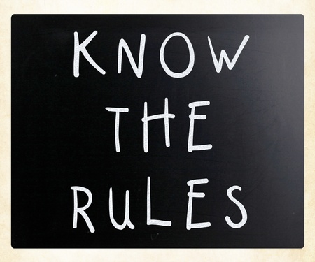 Know the rules - handwritten with white chalk on a blackboard photo