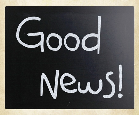 good color: Good News! handwritten with white chalk on a blackboard