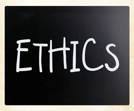 'Ethics' handwritten with white chalk on a blackboard photo