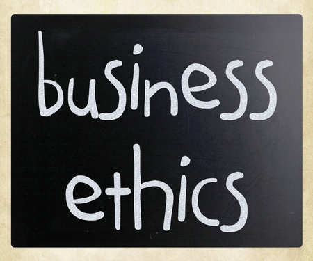 business ethics: Business Ethics handwritten with white chalk on a blackboard