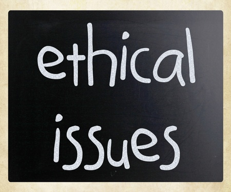 ethical: Ethical issues handwritten with white chalk on a blackboard Stock Photo