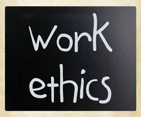 Work Ethics handwritten with white chalk on a blackboard photo