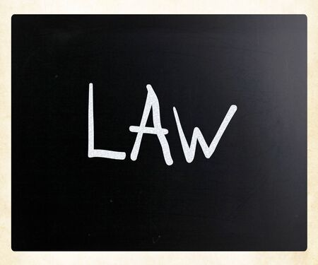 Law handwritten with white chalk on a blackboard photo