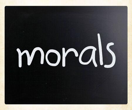 morals: Morals handwritten with white chalk on a blackboard Stock Photo