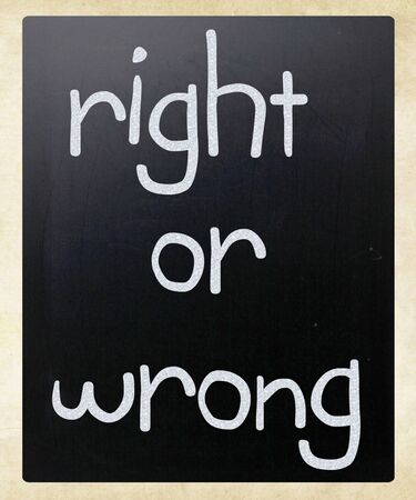 Right or wrong handwritten with white chalk on a blackboard