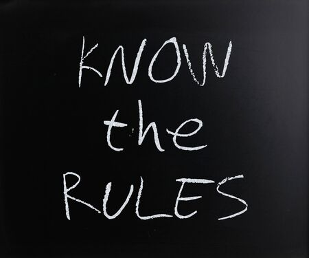Know the rules, handwritten with white chalk on a blackboard. photo
