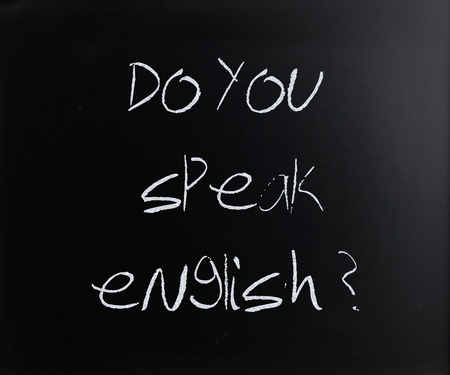 Do you speak english, handwritten with white chalk on a blackboard. photo
