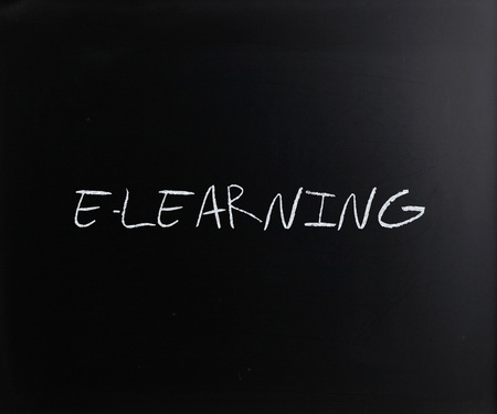 E-learning quote, handwritten with white chalk on a blackboard. photo