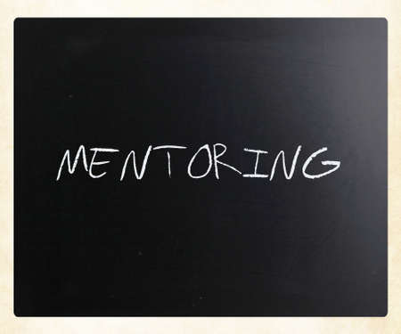 perceived: Mentoring, handwritten with white chalk on a blackboard.