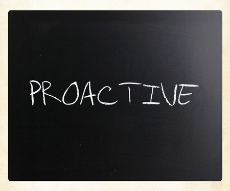The word Proactive handwritten with white chalk on a blackboard. photo