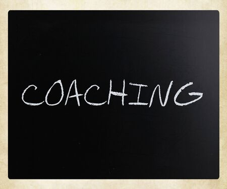 Coaching, handwritten with white chalk on a blackboard. Stock Photo - 13313497
