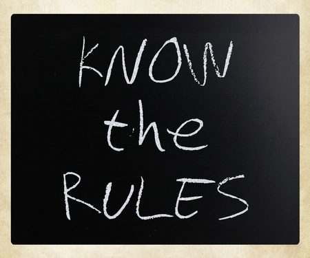 Know the rules, handwritten with white chalk on a blackboard. Stock Photo - 13313528