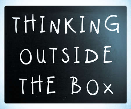 Thinking outside the box phrase, handwritten with white chalk on a blackboard Stock Photo - 13313692