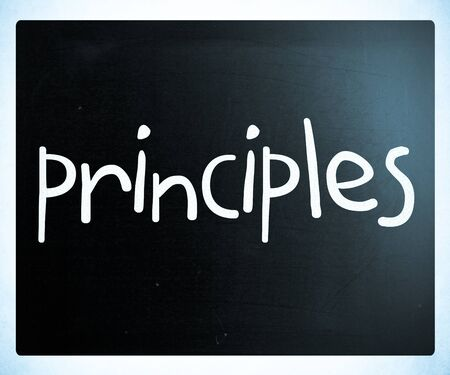 Principles handwritten with white chalk on a blackboard photo
