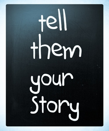 """""""Tell them your story"""" handwritten with white chalk on a blackboard"""